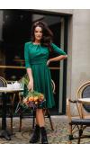 Koktajlowa sukienka midi z rękawem ¾. Pod lekką warstwą szyfonu znajduje się satynowa podszewka.