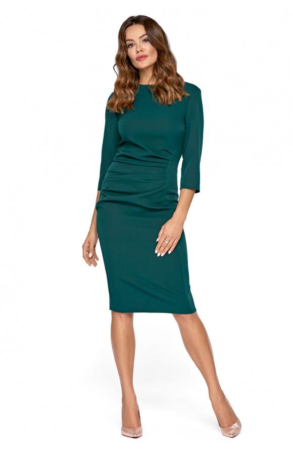 Nieskomplikowana sukienka midi nadająca się na wiele okazji formalnych i nieformalnych.