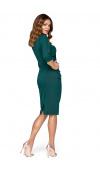 Dopasowana sukienka z bocznym drapowaniem, które świetnie maskuje brzuszek i biodra.