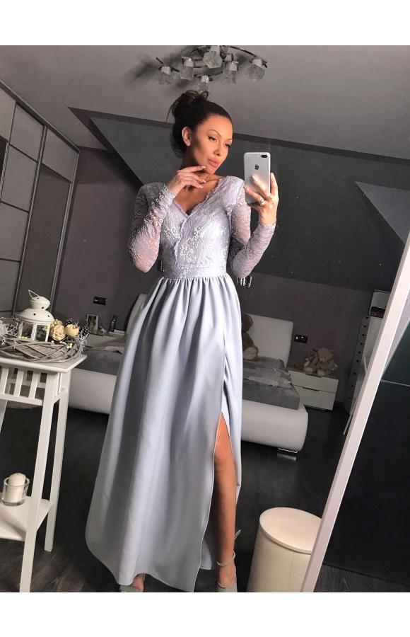 Sukienka odcięta w pasie nadaje genialnych proporcji całej sylwetce.