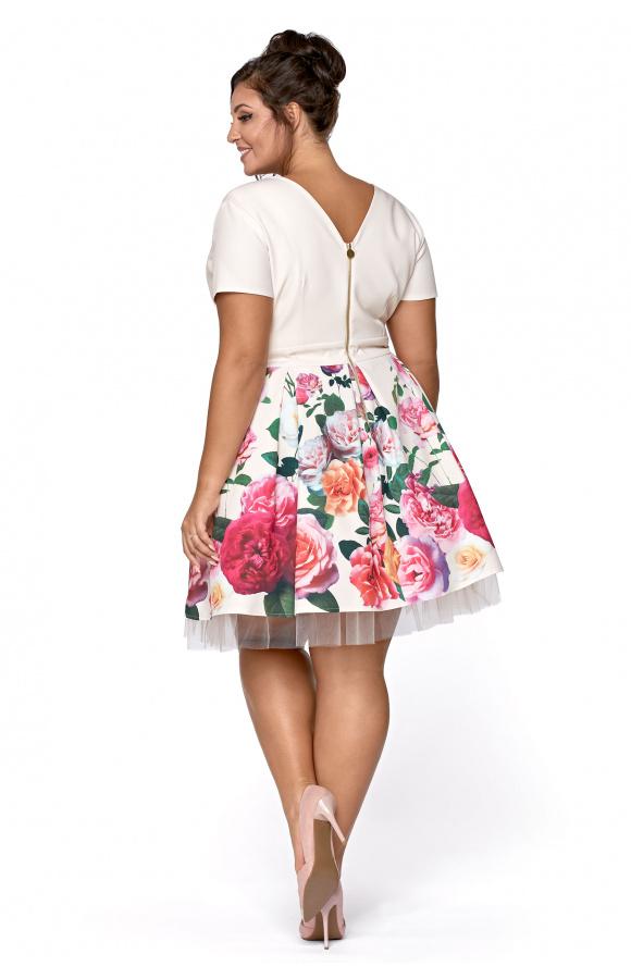 Sukienka z krótkim rękawem i kremową górą z kopertowym dekoltem.