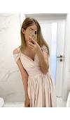 Sukienka ma niewielki dekolt w szpic, który estetycznie łączy się z całą górą.