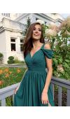 Sukienka ma górę z dekoltem w szpic oddzieloną od spódnicy szerokim pasem marszczonej tkaniny.
