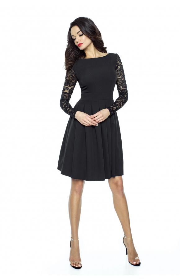 Czarna sukienka midi z długimi rękawami to definicja ponadczasowej elegancji.