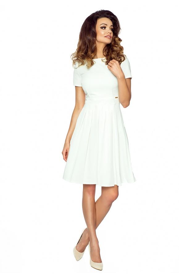 Sukienka z odciętym w talii, rozkloszowanym, plisowanym dołem z kontrafałdami.