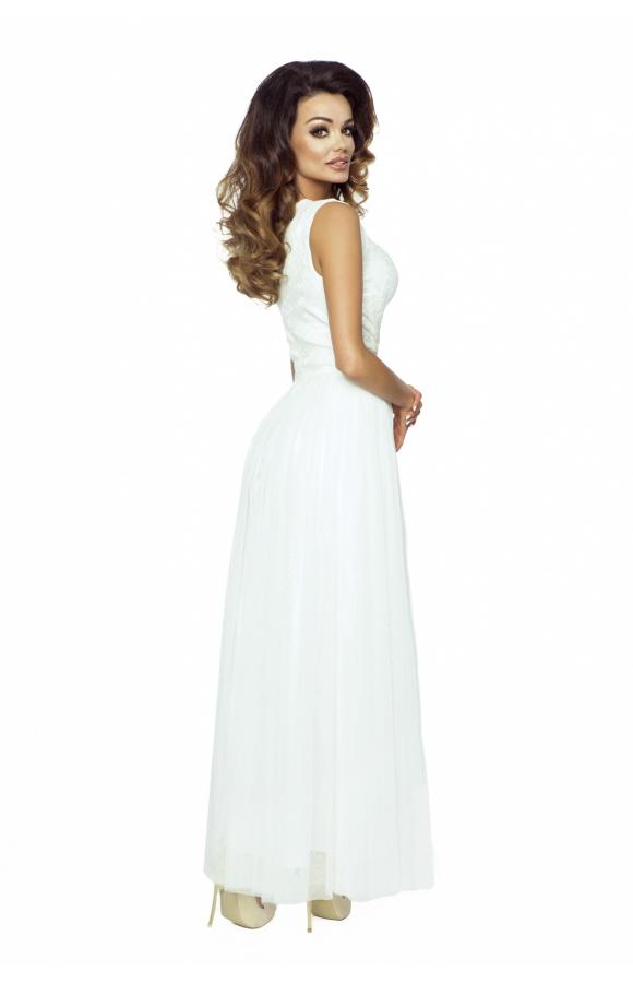 Sukienka bez rękawów i z dekoltem w kształcie litery V. Odcinana spódnica z 4 warstw tkaniny.