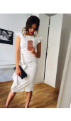 Kremowa sukienka idealna na wyjątkowe okazje, takie jak komunia, chrzciny, ślub cywilny i nie tylko.
