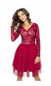 Sukienka z doskonale dobranych tkanin sprawdzi się jako kreacja wieczorowa na wiele okazji.